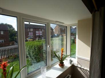 Large window cills are provided by window boxes in the external wall insulation