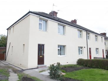 External insulation can be seen on houses