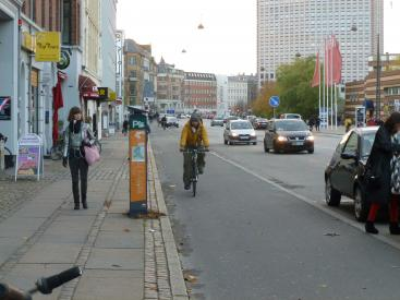 Priority is given to pedestrians, then cyclists, buses and finally cars