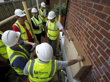 Builders receiving training on different products to retrofit houses.