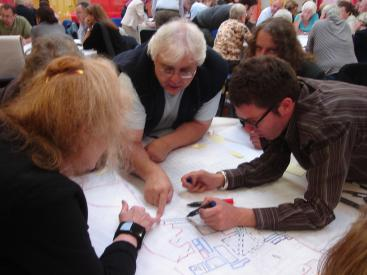 People discuss the masterplan in a consultation session